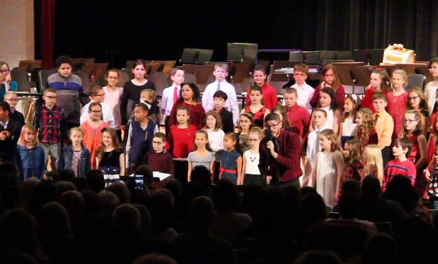 music instructor speaking at winter concert