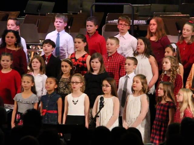 medium shot of students singing at winter concert