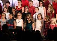 student speaking at winter concert
