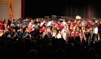 wide shot of students singing at winter concert