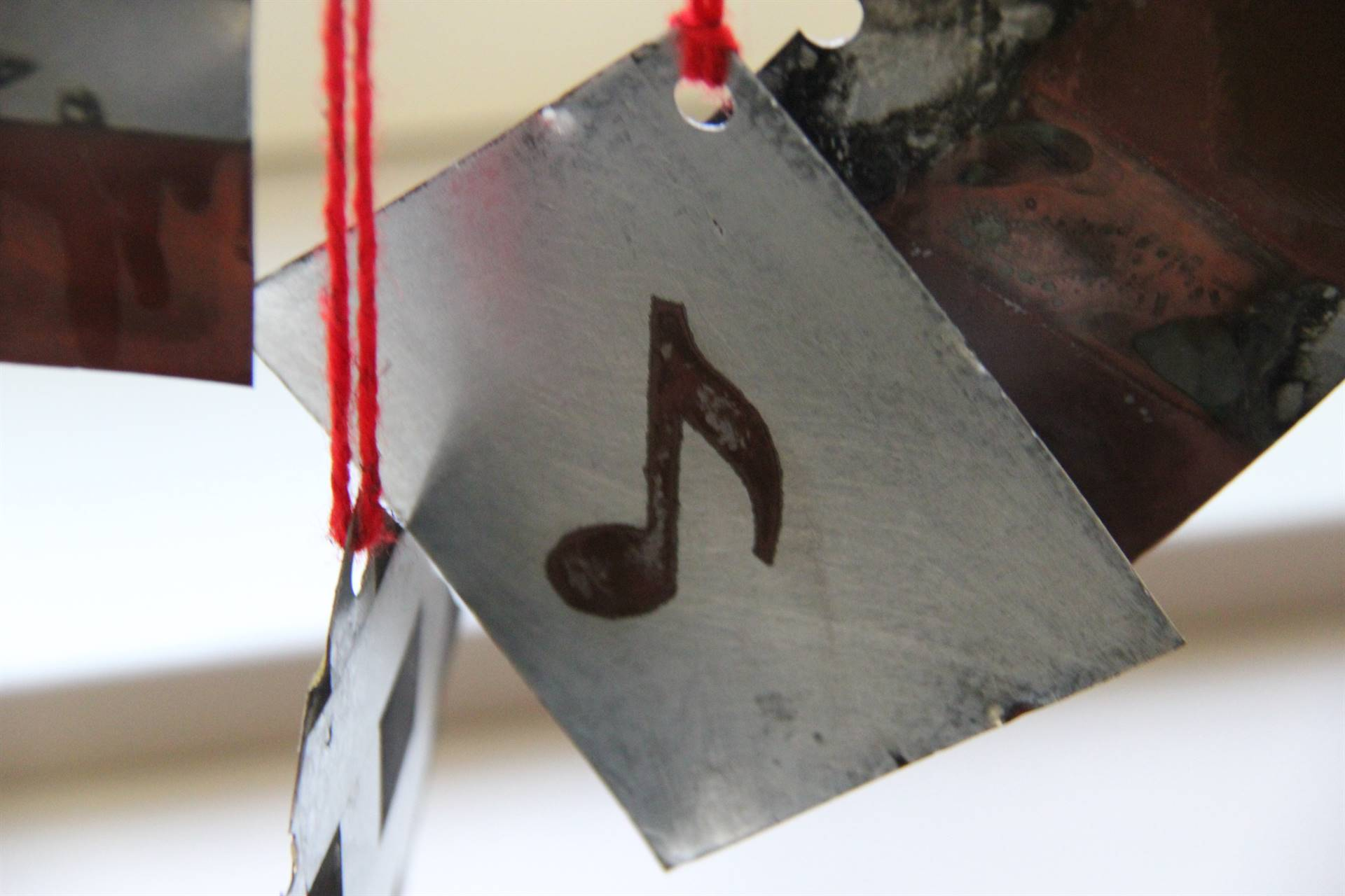 close up of ornament with musical note on it