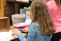 student sitting making habitat