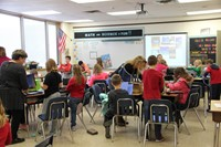 wide shot of classroom of students working on habitats