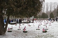 wide shot of cemetary and people standing