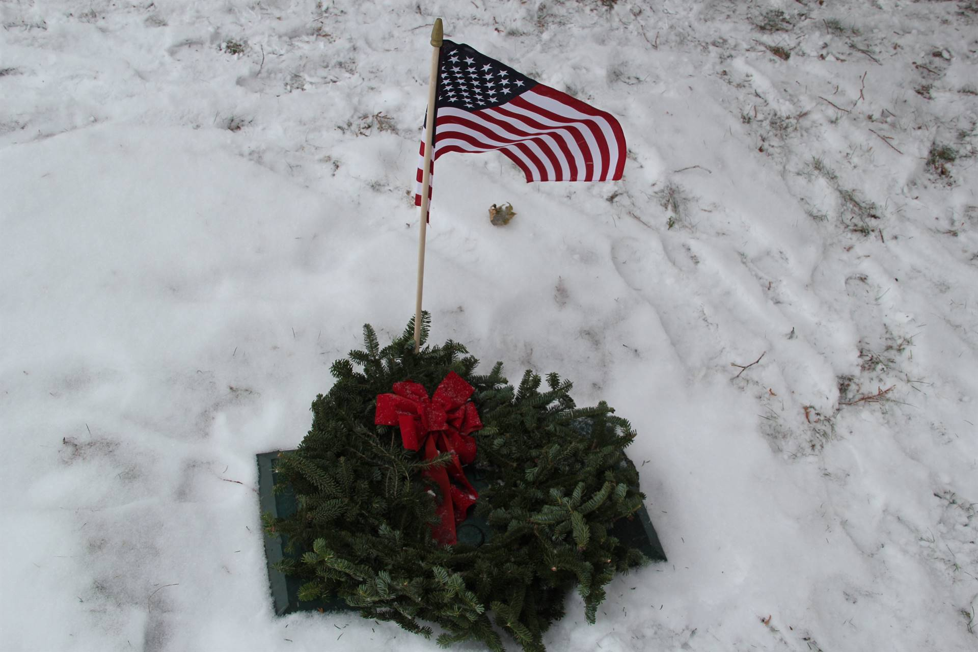 wide shot of wreaths on graves