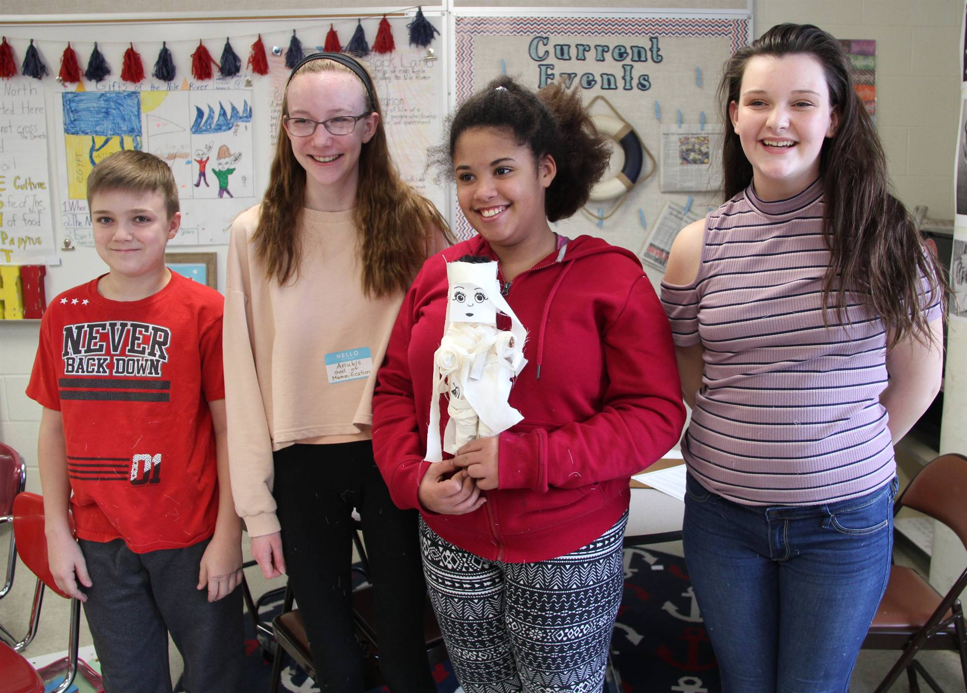 additional students holding doll they mummified