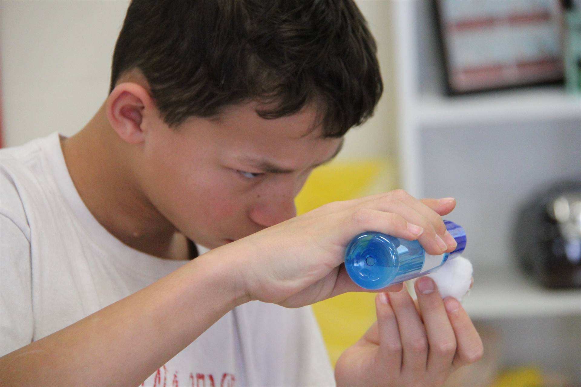 student putting water on cotton swab