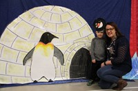 two people standing next to penguin illustration