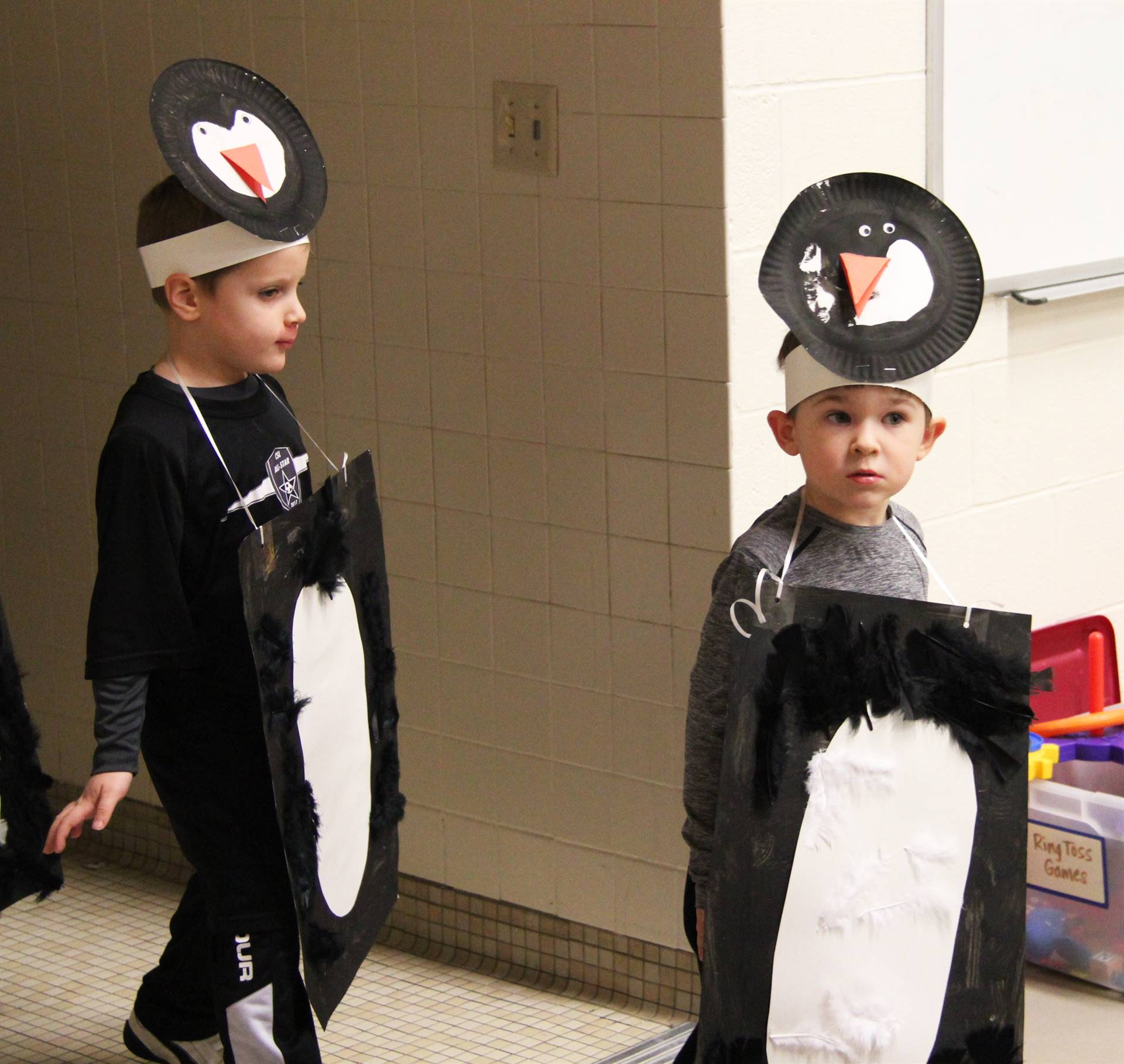 two students with penguin costumes on