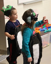 more students dressed up as penguins
