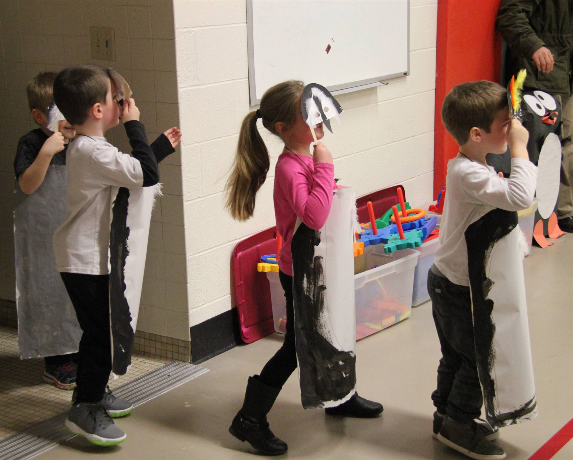 additional students dressed in penguin costumes