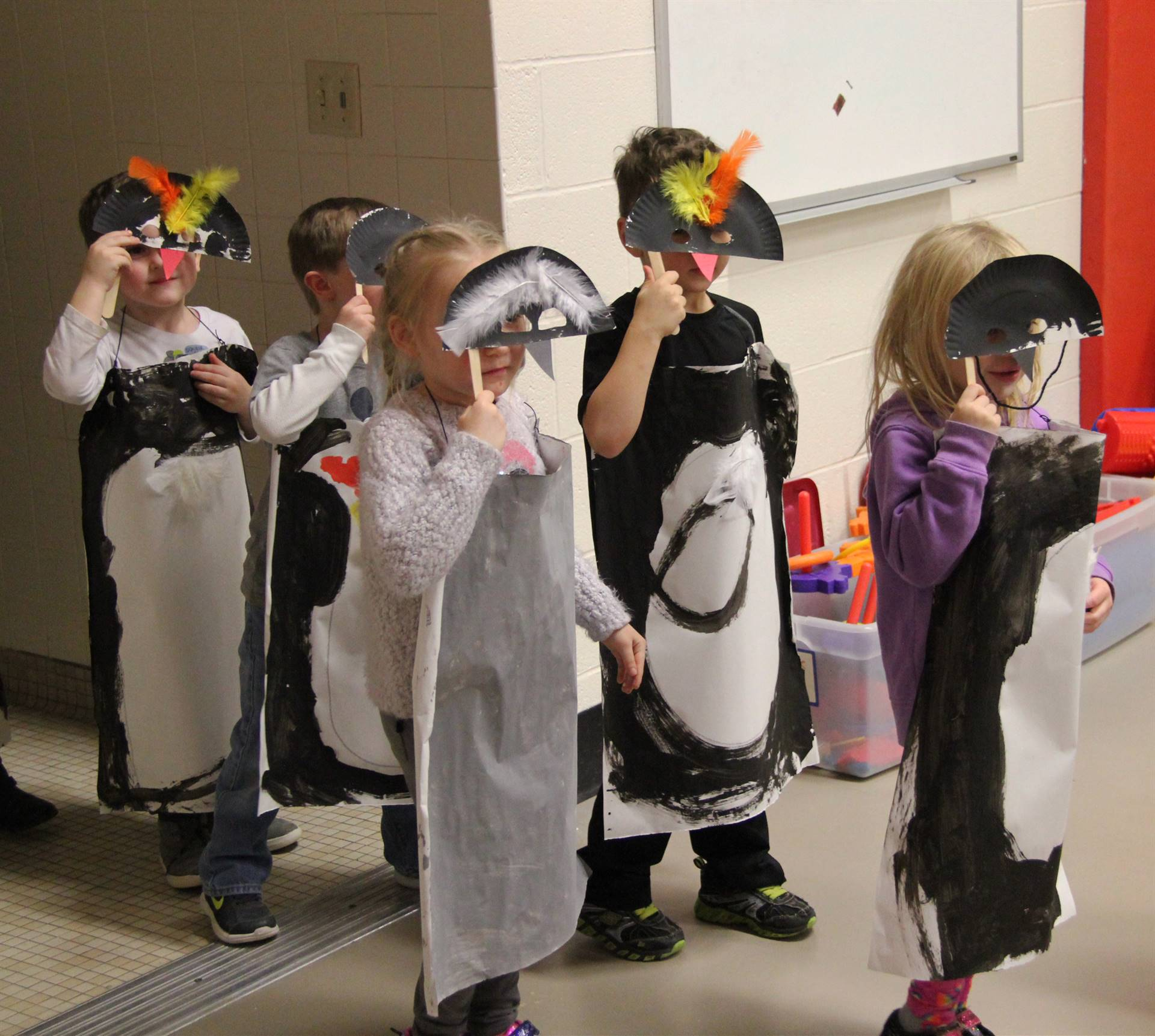 more students dressed in penguin costumes