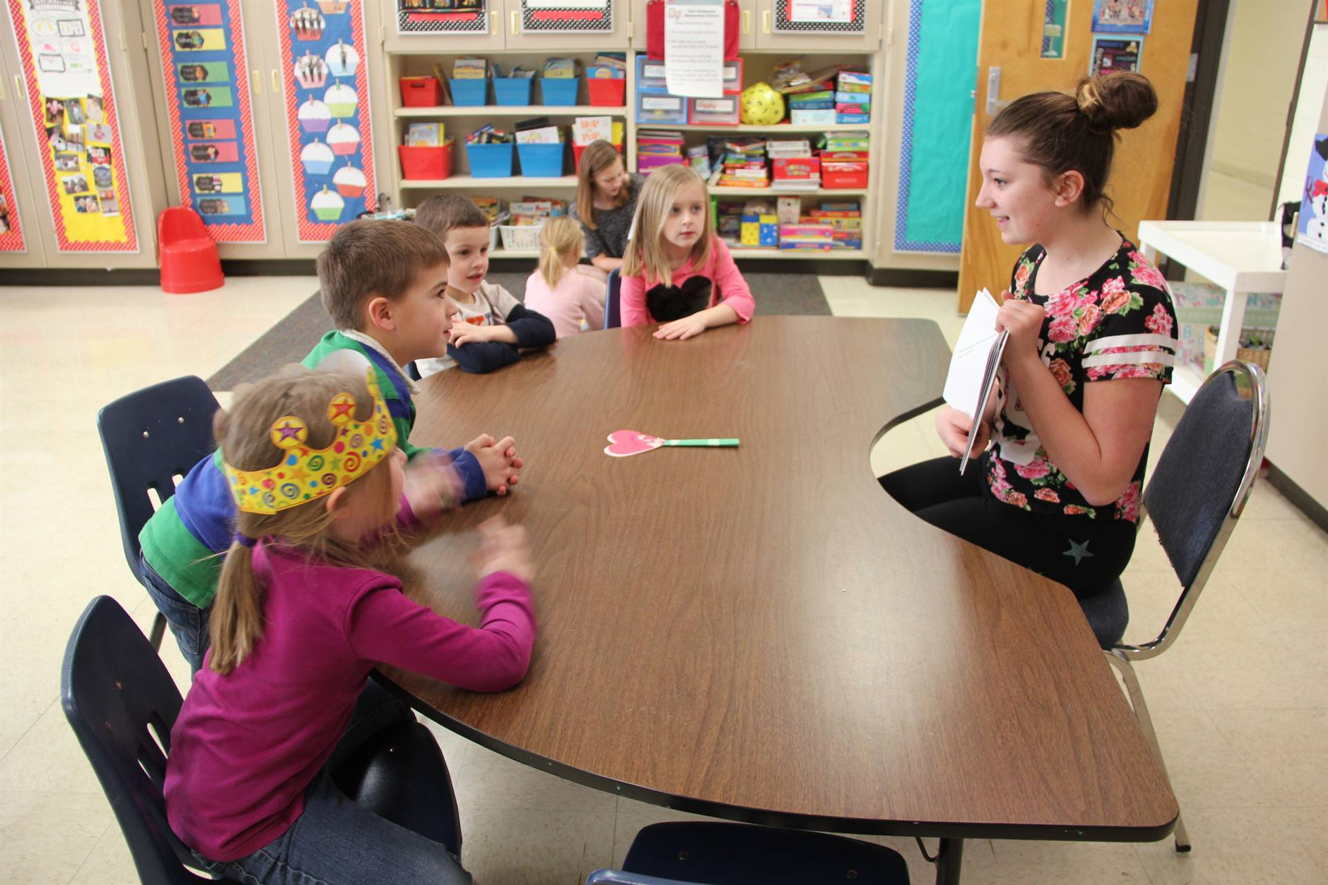 high school student reading to Port Dickinson Elementary Students