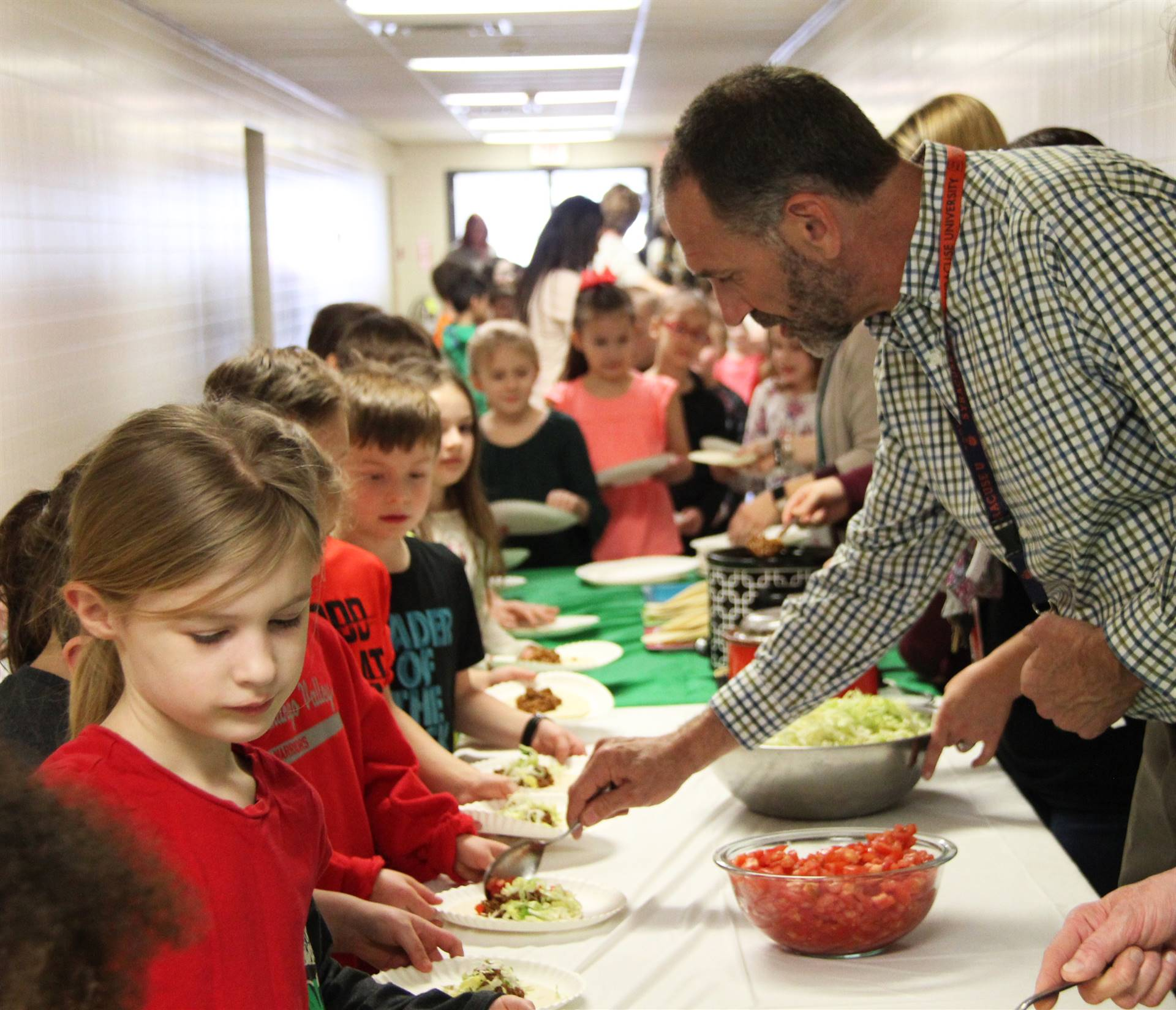 teachers serving students taco ingredients 2