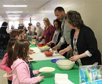 teachers serving students taco ingredients 1