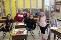 second grade class smiling