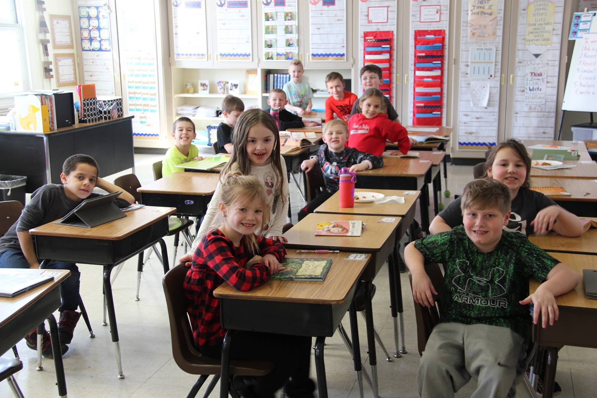 another second grade class smiling