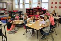 additional second grade classroom smiling