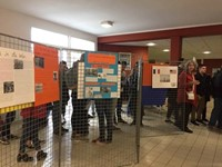 students looking at poster presentations