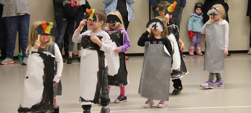 students dressed in penguin costumes