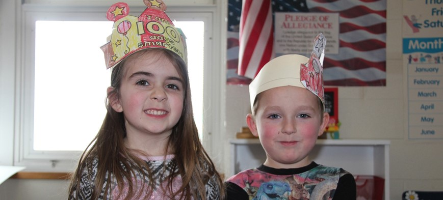 students wearing 100th day of school hats