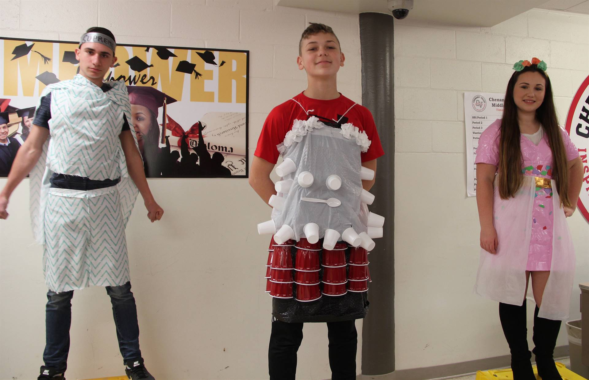 three students dressed up for recycled fashion show