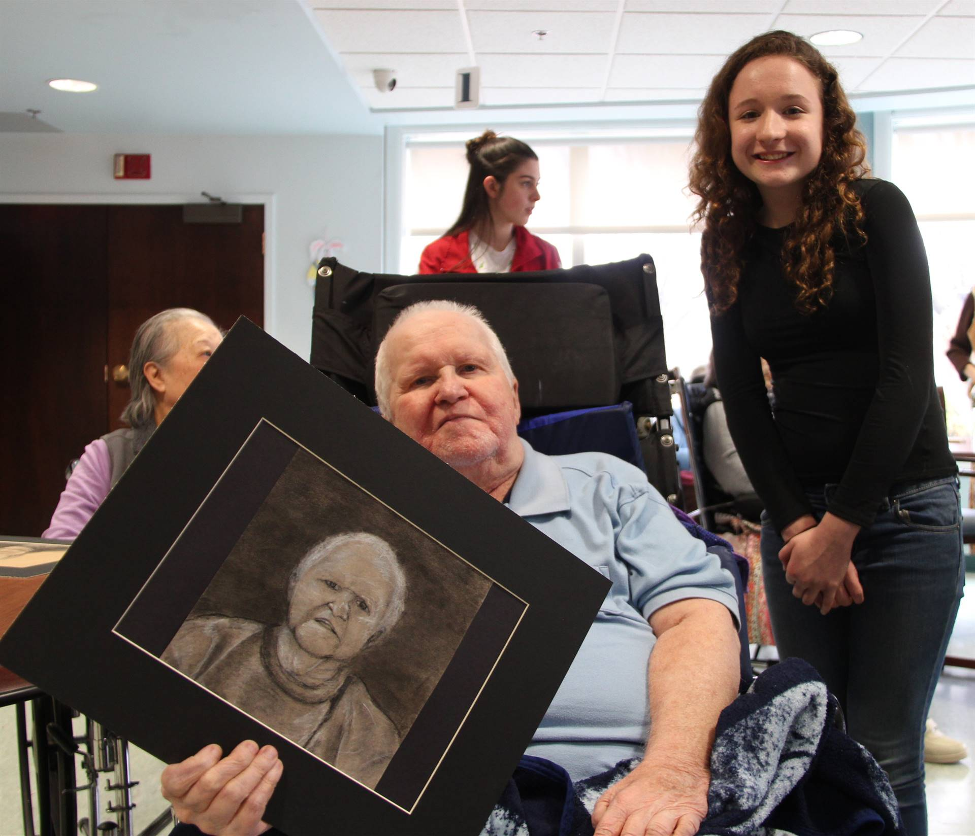 student and man smiling with picture