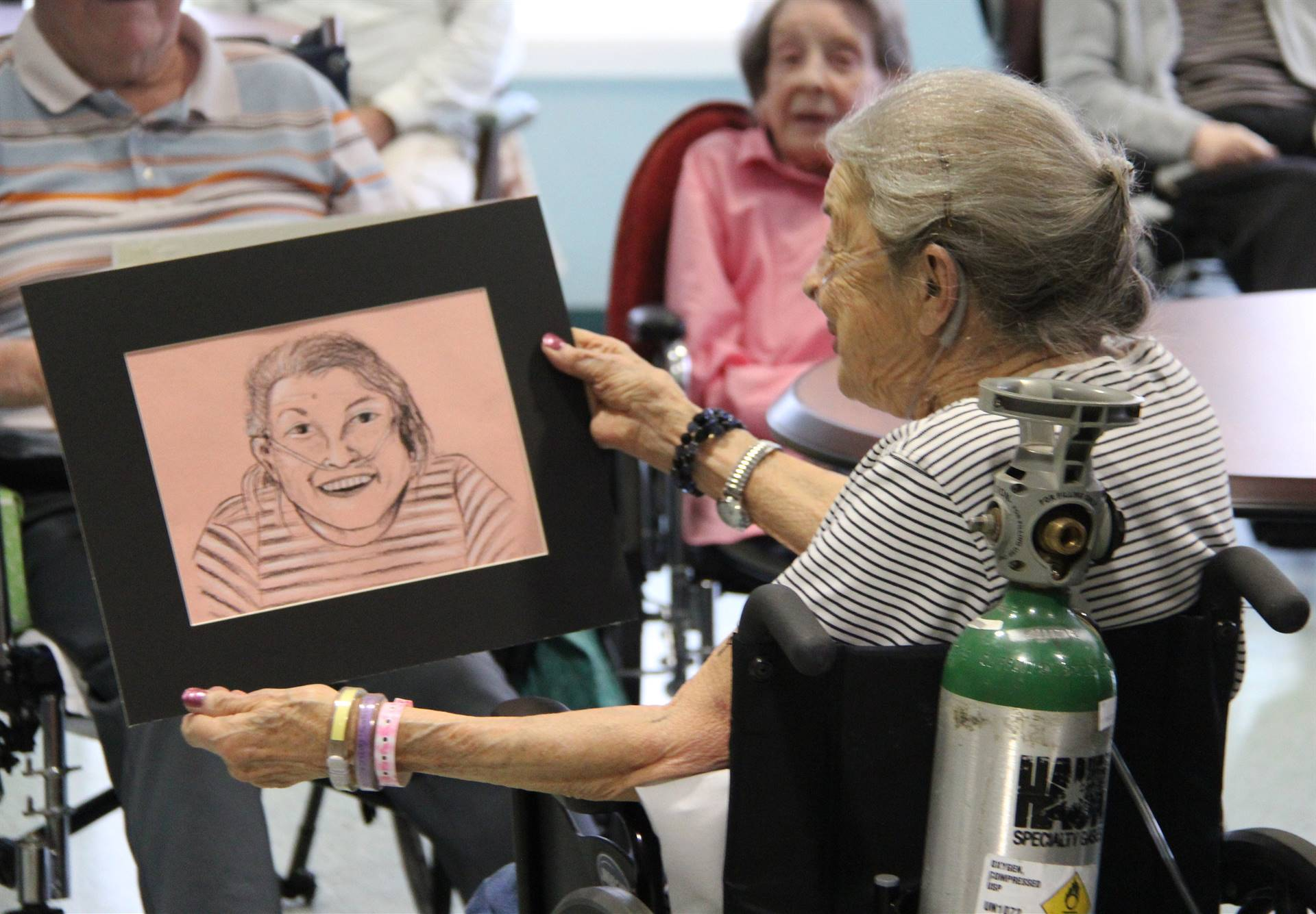 woman smiling looking at drawing of herself