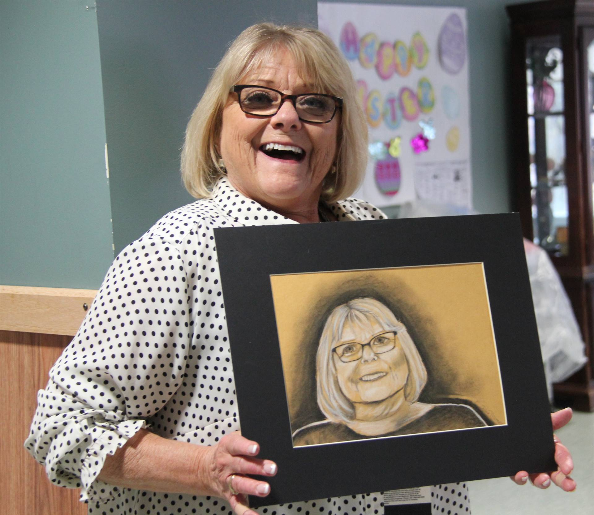 employee smiling with drawing of herself