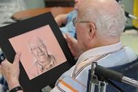 man looking at drawing close up