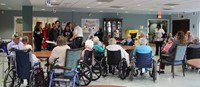 wide shot of nursing home dining room
