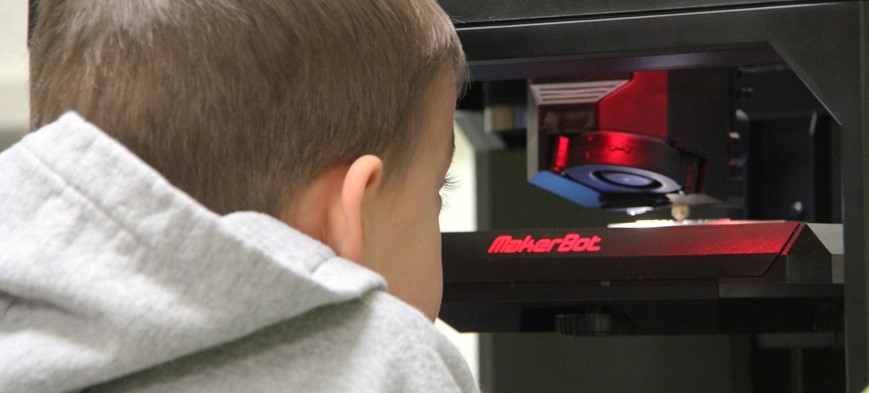 student watching 3 d printer