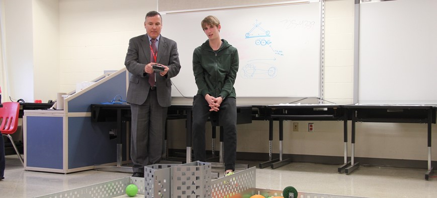 student showing superintendent vex robots