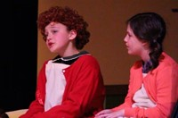 students singing in annie junior
