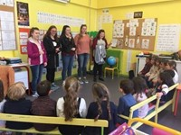 high school students talking to french elementary students