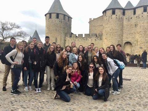 students standing in front of castle