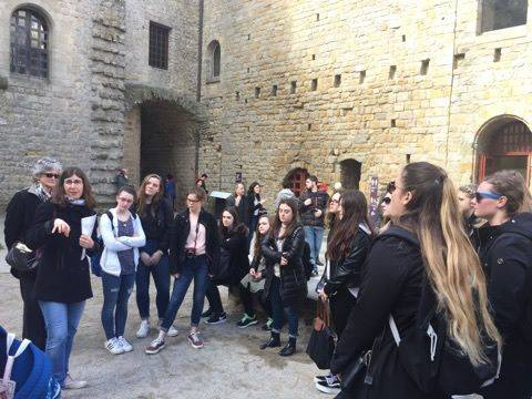 students getting a tour of castle