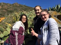 students standing in front of cacti