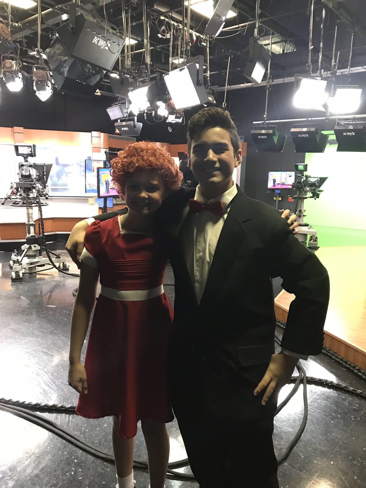 cast members in news studio