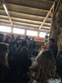 students on tour in barn