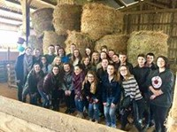 group of students in barn