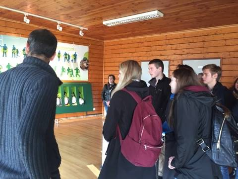 students looking at demonstration board