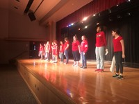 students lined up on stage