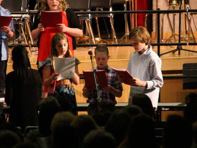 three students singing