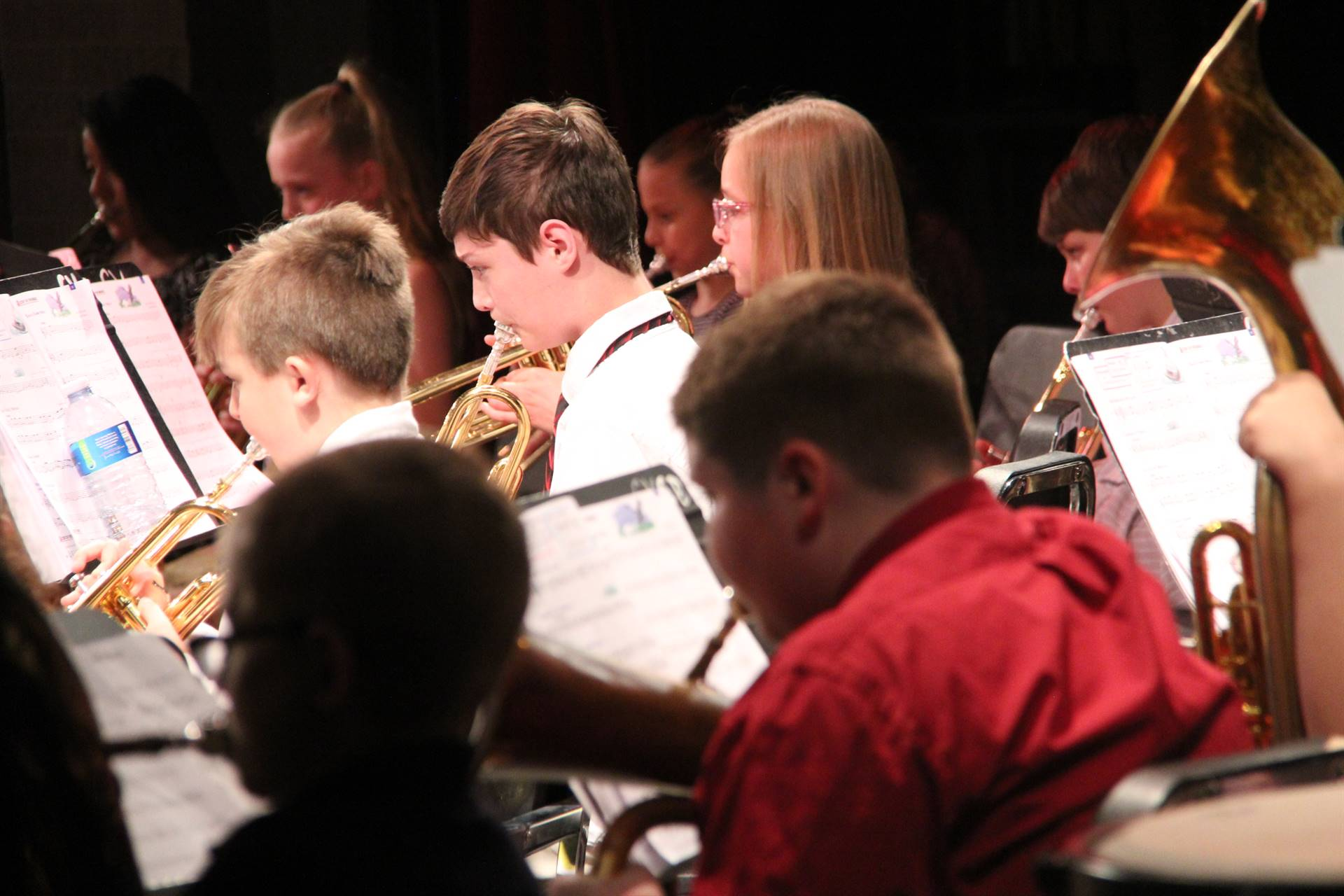 medium shot of students playing instruments
