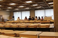 wide far shot of students learning about book records