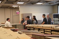 wide shot of students learning about book records