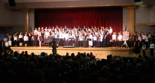 middle and high school choruses singing