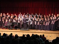 wide shot of students singing
