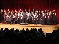 wide shot of students singing duet